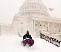 Child sledding down U.S. Capitol steps