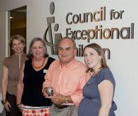 Greg LaMore, Michigan CAN Coordinator, receives CEC's Outstanding CAN Coordinator Award.
